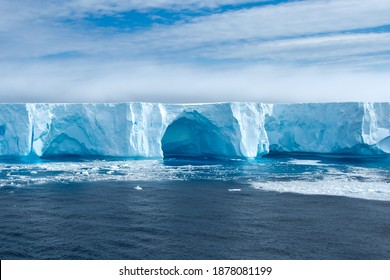 Beautiful blue iceberg and ice floe in Admiralty bay, Antarctica.