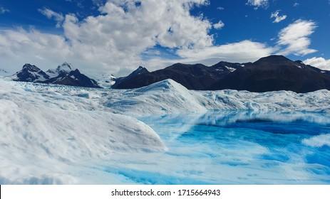 Beautiful blue lagoon on the top of the Perito Moreno Glacier