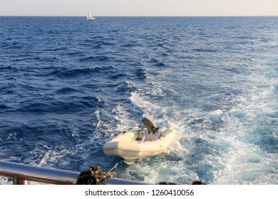 Beautiful blue lagoon. Sea view, water with waves around the boat ship yacht. Red Sea, Egypt, Hurgada. Sea view with white motor boat in waves with foam. Deep blue sky and crystal water landscape