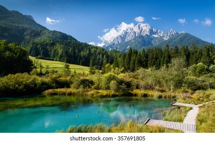 beautiful blue lake in alps with mountains scenery