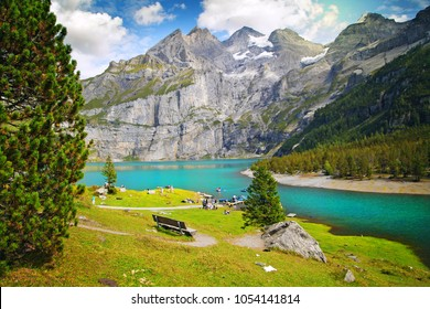 beautiful blue lake oeschinensee, in Switzerland, a fantastic mountain landscape overlooking the water and forest