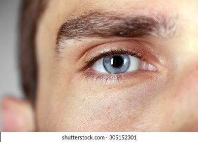 Beautiful blue man eye close up