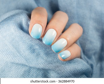 Beautiful blue manicure in light