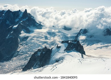 Beautiful blue morning landscape with clouds over alps in Mont Blanc massif from Aiguille du Midi 3842m, Chamonix, France