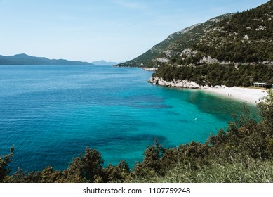 Beautiful Blue Ocean Water and Sandy Beach in Croatia