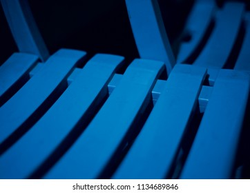 Beautiful blue plastic parts of a chair isolated unique background photo