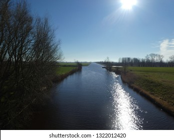beautiful blue river in the Netherlands.  blue Sky and trees, waterreflection