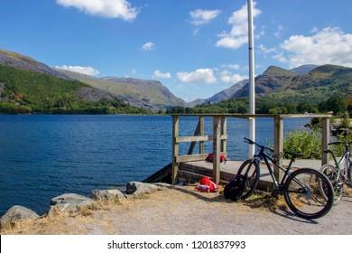 Beautiful Blue Scene of Bicycle in front of Lake Padarn, Llanberis, Snowdonia, Wales