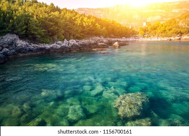 Beautiful blue sea bay with cristal water on sunset