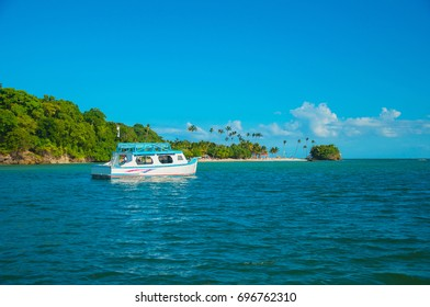 Beautiful blue sea and sky view with boat Caribbean sea coast Bacardi Island resort.