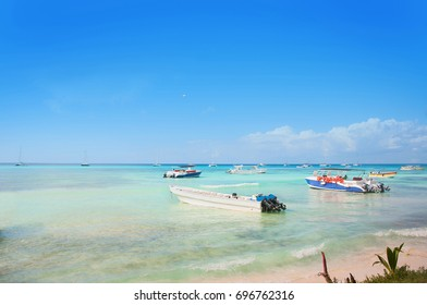 Beautiful blue sea and sky view  with boats Caribbean sea coast Saona Island resort.