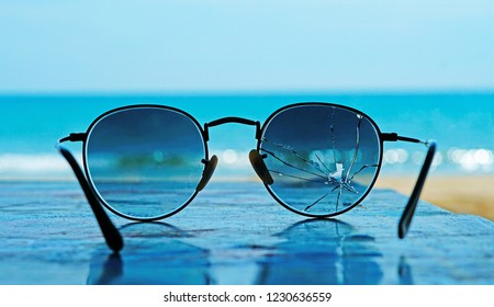 A beautiful blue sea that was seen through the broken sunglasses. Although not perfect, it is beautiful.
