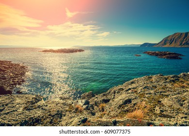 Beautiful blue seascape at sunset. Wild nature Norway.  Nordkapp, Mageroya island. Honningsvag