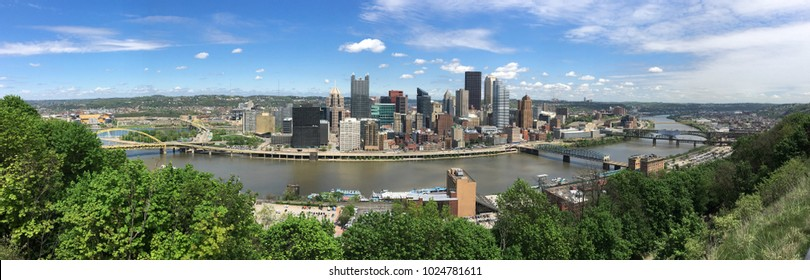 A beautiful blue sky clear day over the downtown city skyline in Pittsburg PA