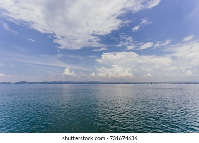 Beautiful blue sky with clouds above the sea