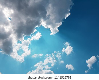 Beautiful blue sky with clouds background. Blue sky with clouds close-up.