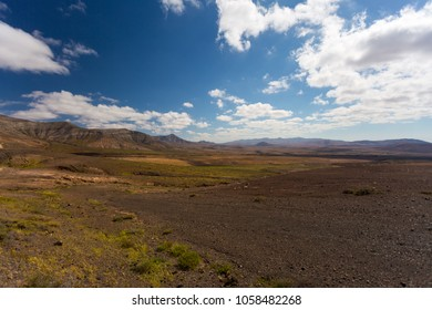 Beautiful blue sky with clouds and mountains, breathtaking view, amazing nature. Fuerteventura to Lanzarote, Spain, Europe.