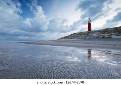 beautiful blue sky and clouds over red lighthouse, Netherlands