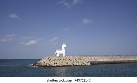 beautiful blue sky, clouds, sea and horse pharos