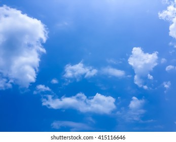 Beautiful blue sky and clouds with sunlight on top - Shutterstock ID 415116646