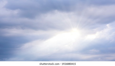 Beautiful blue sky and dark clouds with dramatic light in the evening before sunset light penetrates through the clouds, causing the beam, Twilight sky background.