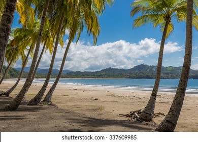 Beautiful blue sky day with a blue sea and empty sand. Playa Samara, Costa Rica, Central America.