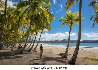 Beautiful blue sky day with a blue sea and empty sand. Playa Samara, Costa Rica, Central America.