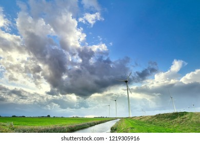 beautiful blue sky over Dutch countrysise with wind turbines
