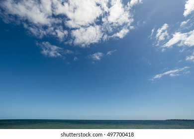 A beautiful blue sky over the green sea during one warm summer.