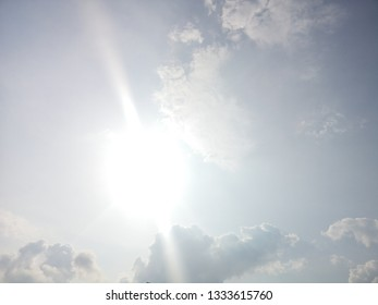 The beautiful blue sky and the sun with white cloud background, Beautiful landscape, Copy space for text.