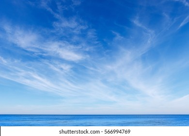 beautiful blue sky with white Cirrus clouds and calm blue sea