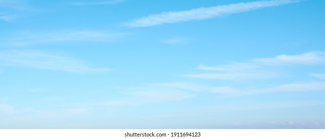 Beautiful blue sky and white clouds of various shapes with sunlight. Nature background