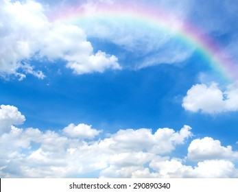Beautiful blue sky and white clouds with rainbow in good weather and summer day. Photo for background.