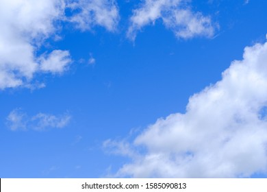 Beautiful blue sky with white gorgeous fluffy cloudy flowing with the wind