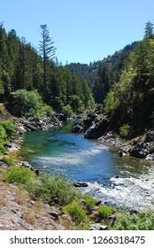The beautiful blue Smith River near Gasquet, California (Northern California, Southern Oregon); Summer, sunny, rafting, swimming, hiking spot along Highway 199