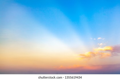 beautiful blue sunset sky with white clouds background, Nature background, yellow and orange tone