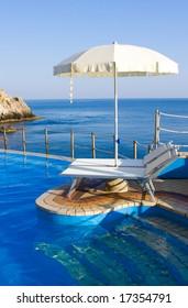 Beautiful blue swimming pool on the seaside