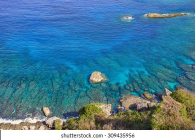 A beautiful blue tropical ocean converging with a shallow reef. This photograph was taken on the island of Saipan.