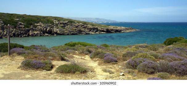 Beautiful blue water of Natural Reserve of Vendicari (Reserva Naturale di Vendicari) in Sicily, Italy - a place for summer holidays and trekking activity