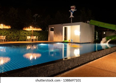 Beautiful blue water at night ,swimming pool for background.