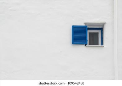 Beautiful blue windows Greek Style on white wall