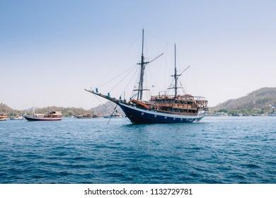 Beautiful blue yacht seen on the ocean