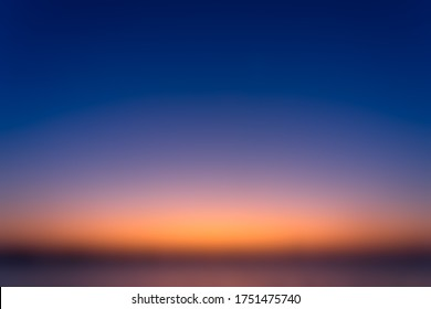 Beautiful blurred sky before sunrise with a natural gradient of orange and blue sky background.