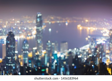 beautiful blurry hongkong cityscape view from above at night with shiny city light from sky high building