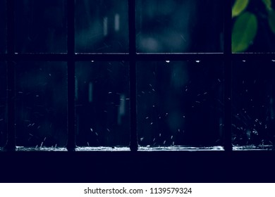 Beautiful blurry scattered rain water drops falling on a surface unique photo