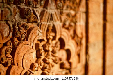 A beautiful blurry sculpture design on an exterior wall of an ancient building photo