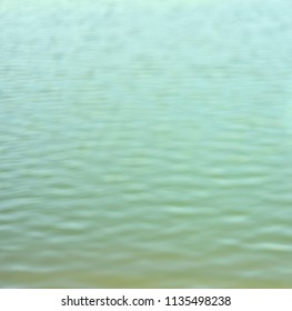 Beautiful blurry water waves of a lake unique background photo