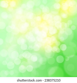 Beautiful blurry yellow and green spring bokeh abstract light illustration background.