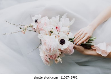 Beautiful blush pink bouquet in bride's hands. Wedding bouquet with ranunculus and poppy flower