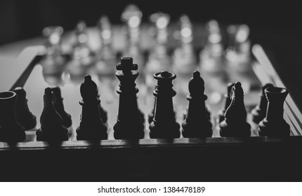 A beautiful board with chess pieces.